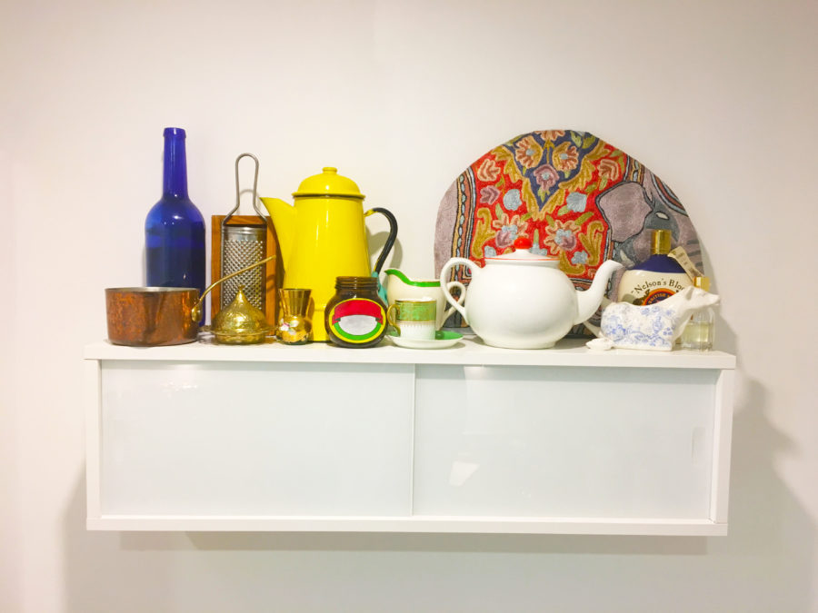 Kitchen shelf with tea pot and marmite pot