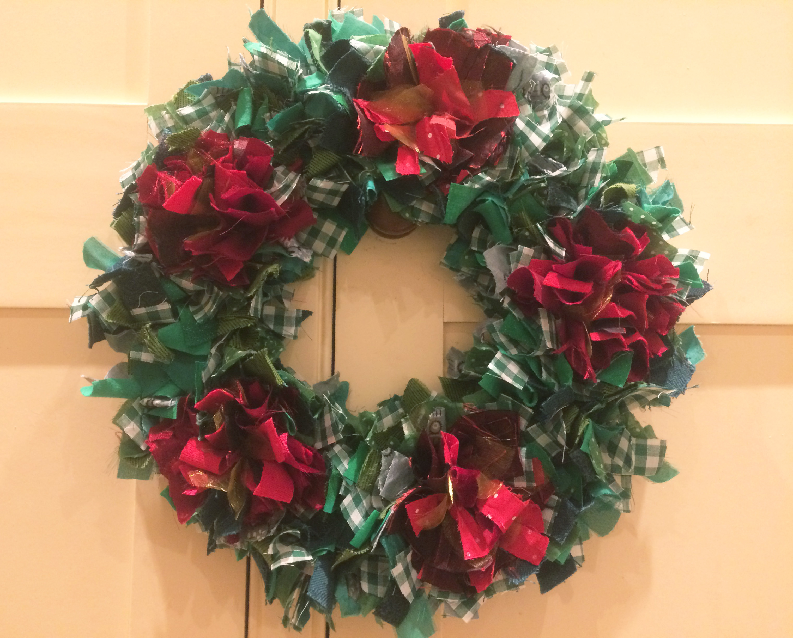 Traditional shaggy rag rug christmas wreath made using recycled materials by Cathy.
