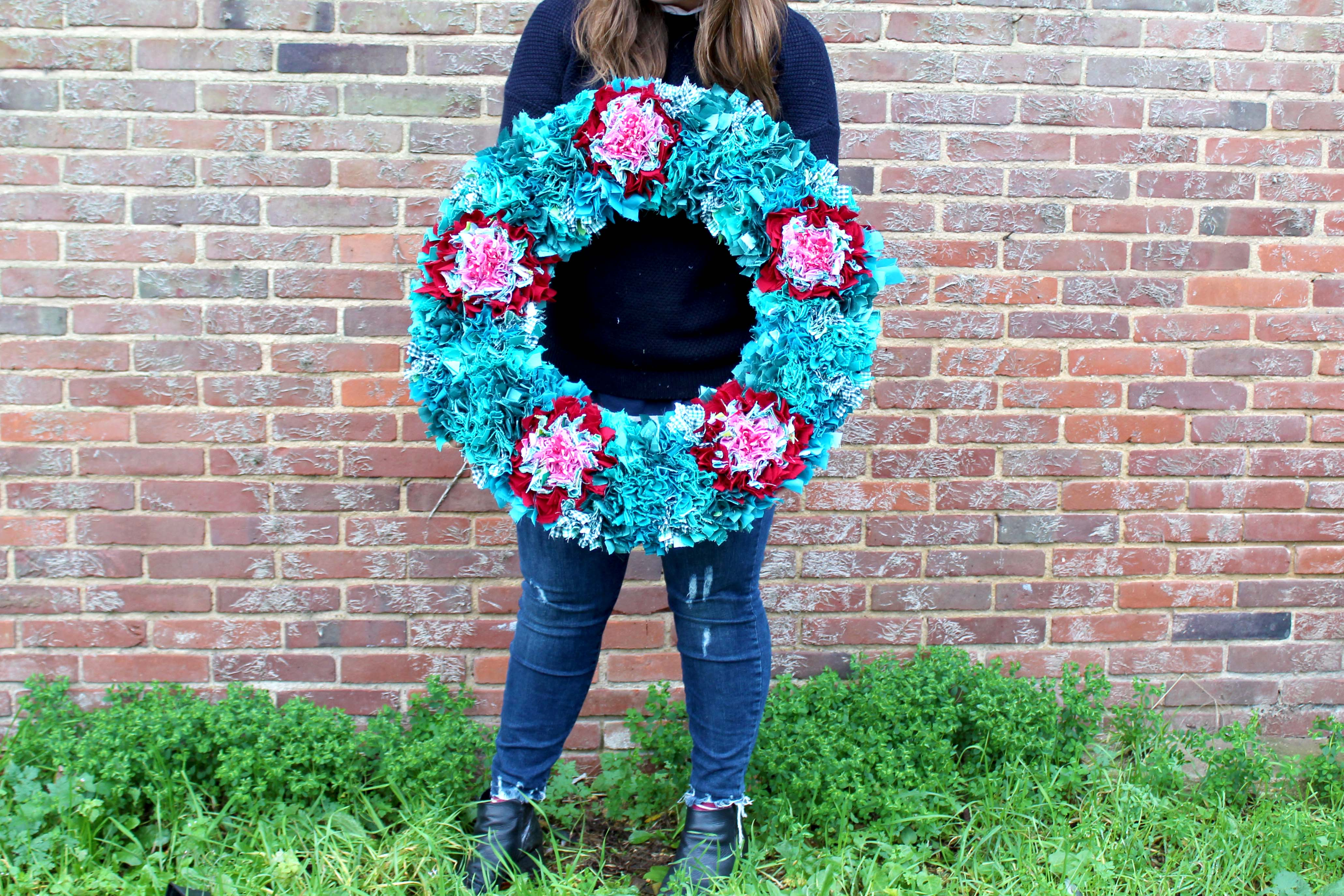 Extra large green and red rag rug xmas wreath made using recycled clothing and sewing offcuts.