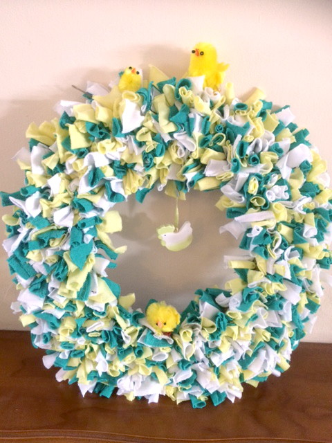 Green, yellow and white rag rug easter wreath made on hessian using recycled clothing and t-shirts.