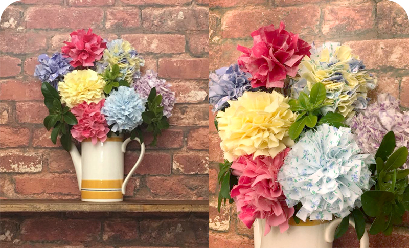 Pastel rag rug flowers in a vintage coffee pot