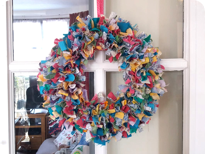 Multicoloured Spring Rag Rug Wreath made using fabric offcuts and old clothing scraps