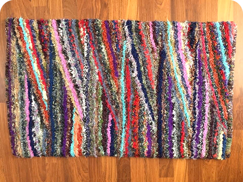 Diagonal striped rag rug