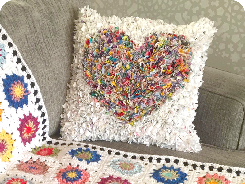 Shaggy rag rug heart cushion in white and multicoloured fabrics