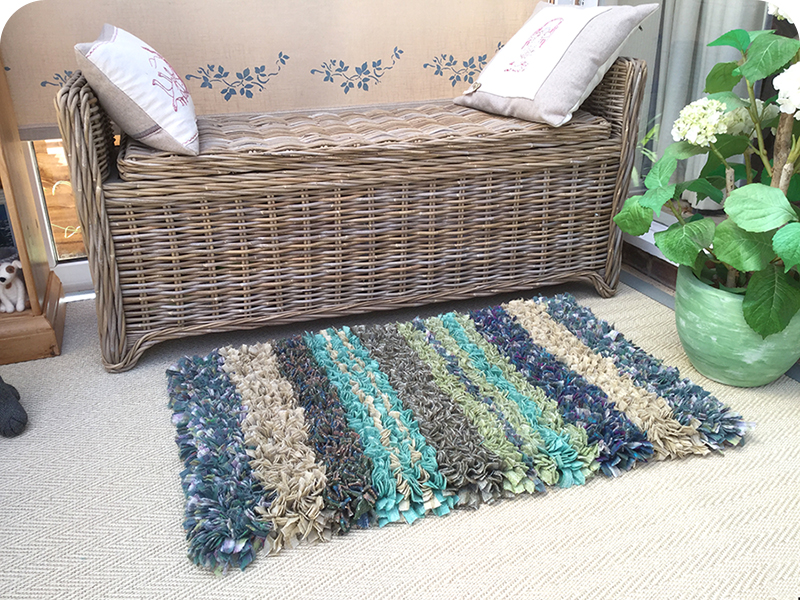 Blue green and cream striped proggy rag rug