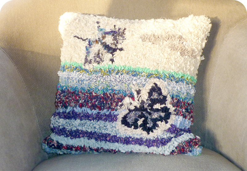 Hooky rag rug cushion with butterflies