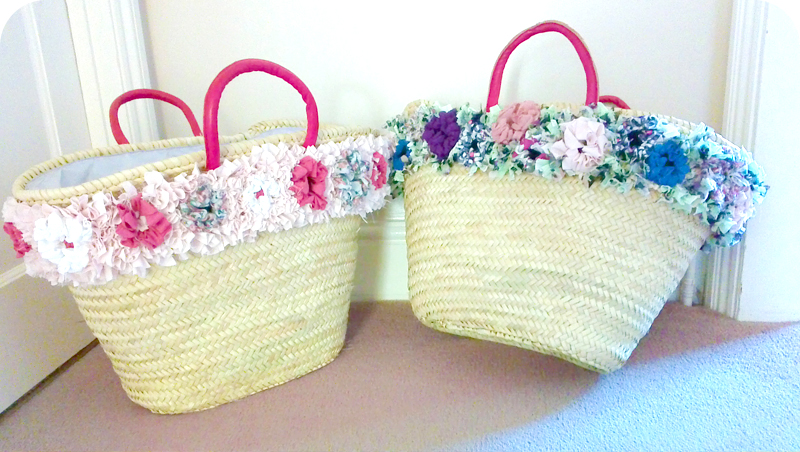 Wicker baskets with rag rug flower trim in the shaggy rag rug technique