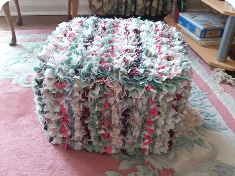 pink and green rag rug pouffe with stripes