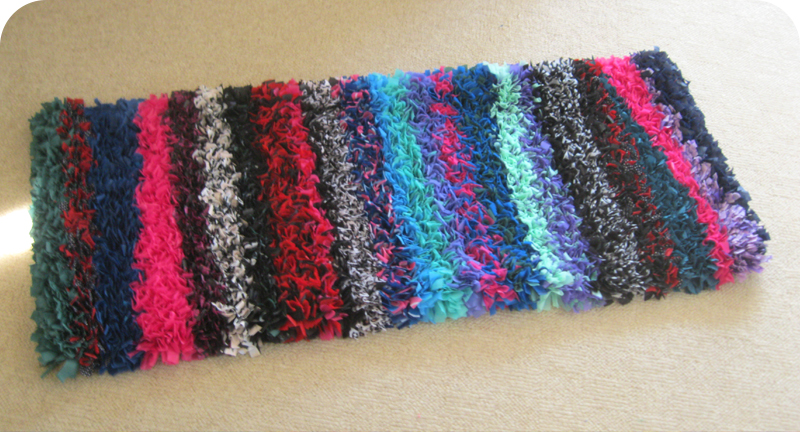 Stripey rag rug made using old broken umbrellas