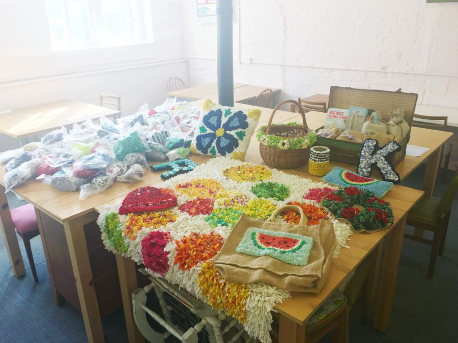 Ragged Life Rag Rug Pieces on a table before a full day rag rug workshop
