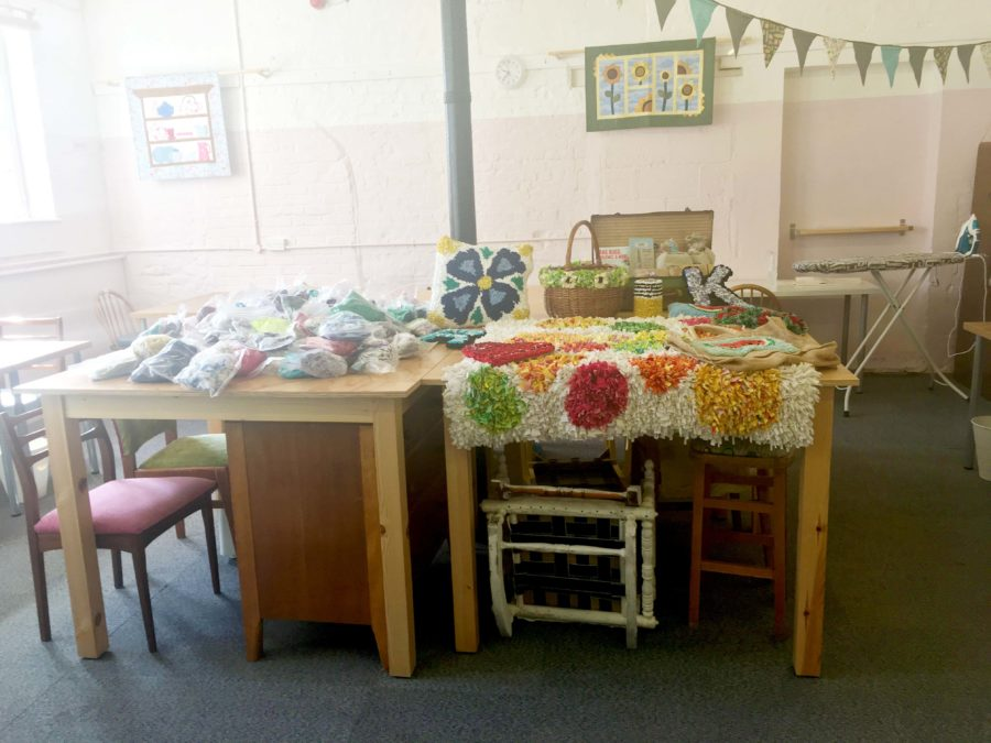 A display of rag rug pieces on a table in the Craft Space in Trowbridge