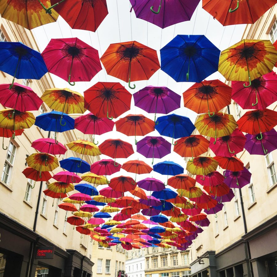 Colourful umbrellas suspended over the road in Bath City Centre