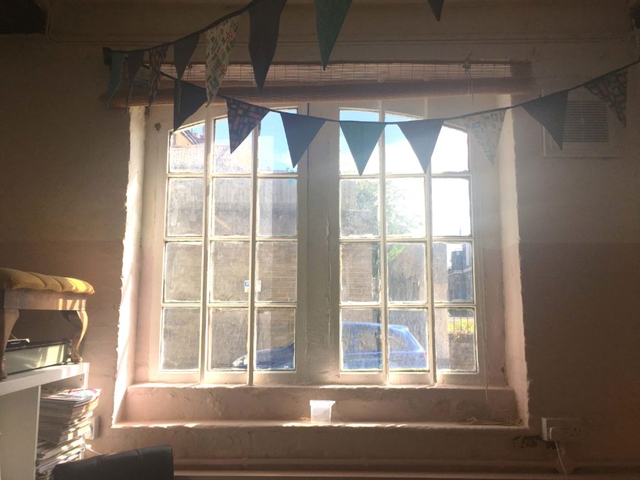 A Window with Bunting at The Craft Space in Trowbridge