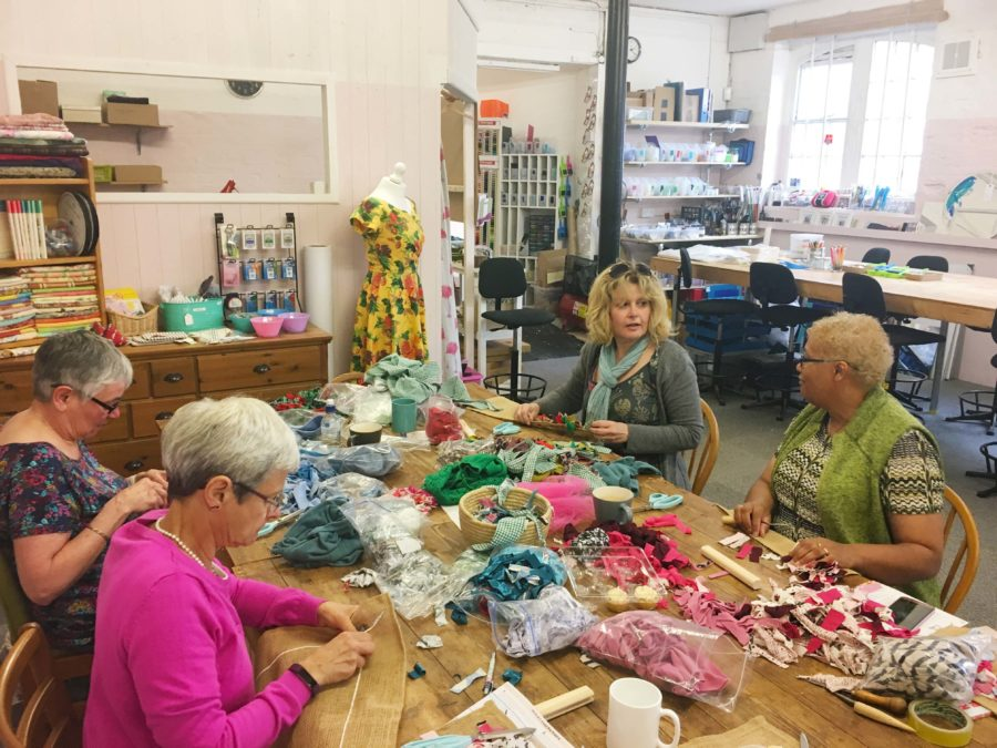 Four ladies having fun taking a Wiltshire rag rug workshop in The Craft Space