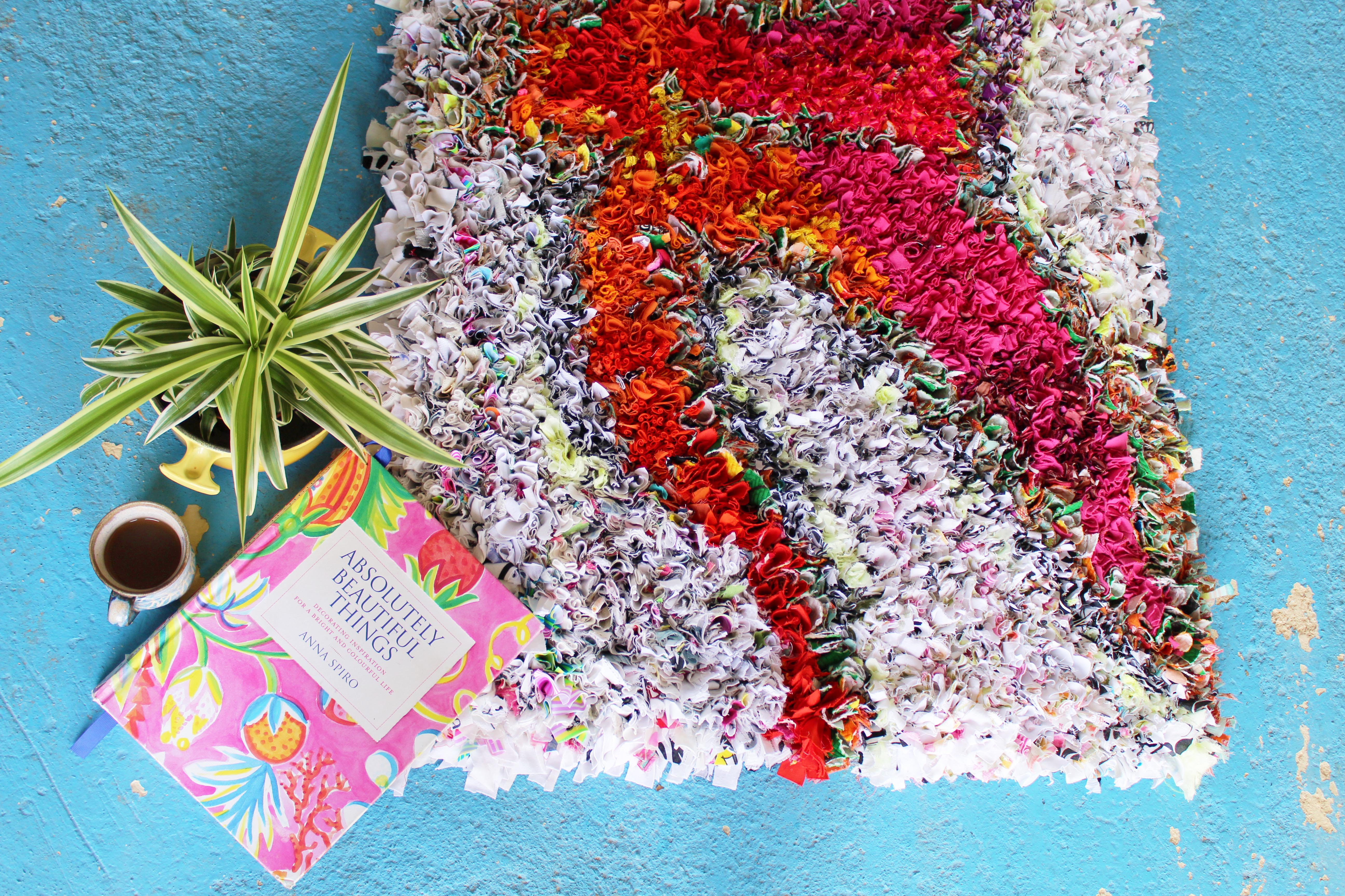 Absolutely Beautiful Things Book by Anna Spiro on top of a Rag Rug with a Palm and coffee