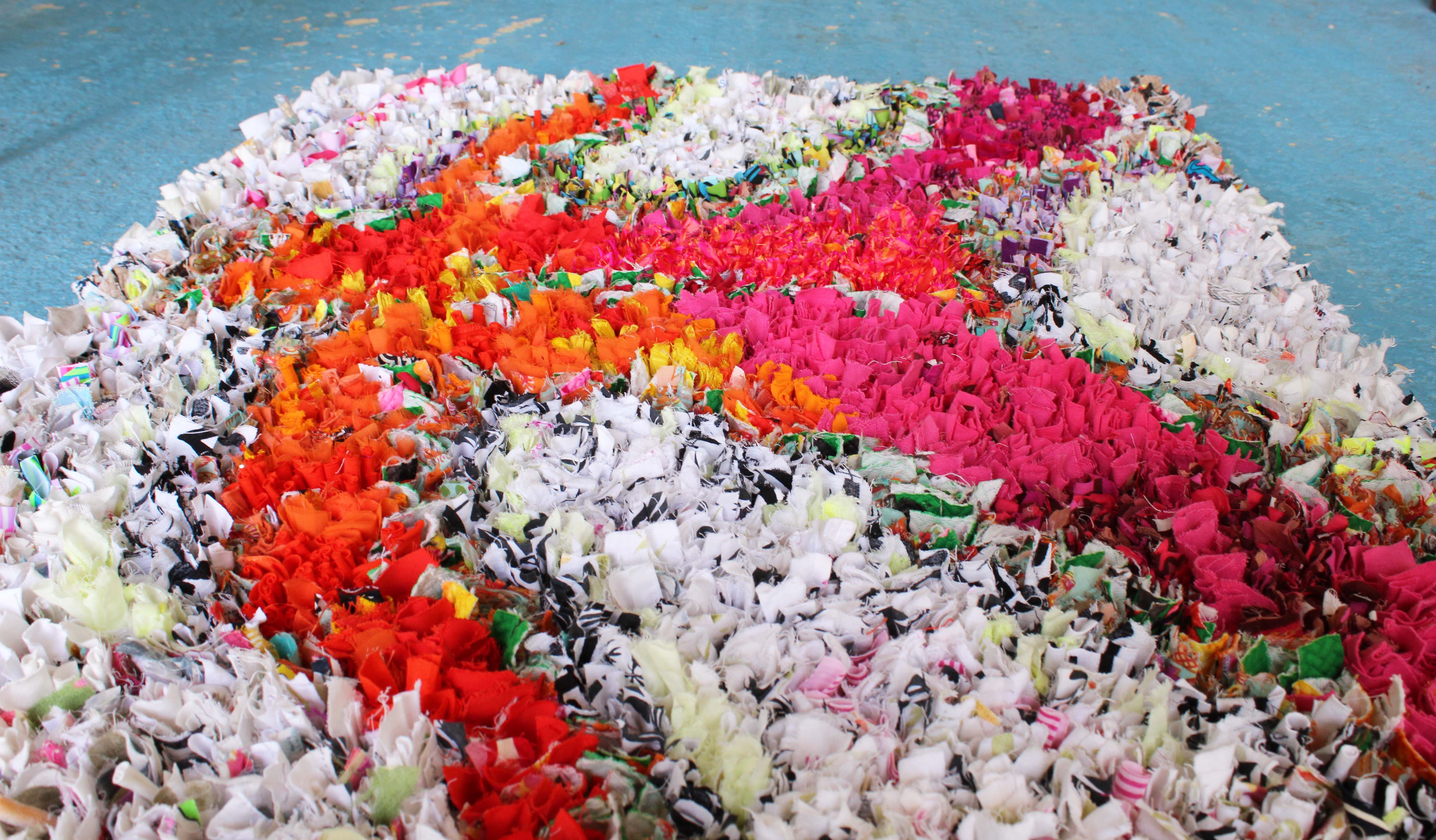 An intricate rag rug design made using old t-shirts and fabric offcuts