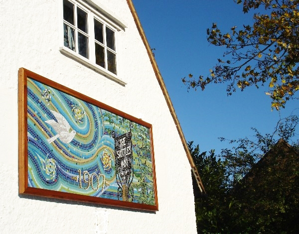 The Bird and Sky Mosaic on the side wall of the Settlement in Letchworth Garden City