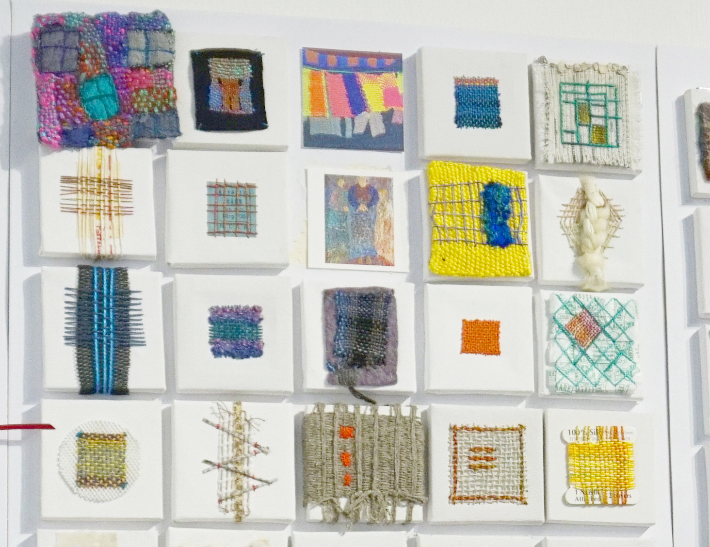 Small detailed pieces of textile art in an exhibition at the Knitting and Stitching Show 2017