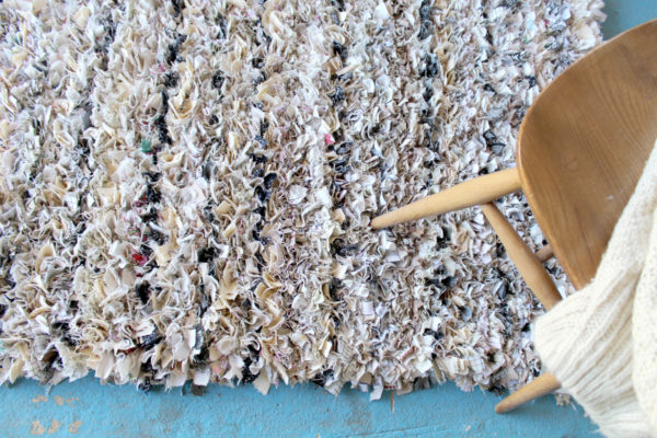 cream shaggy rag rug on floor with chair on top made out of old sheets