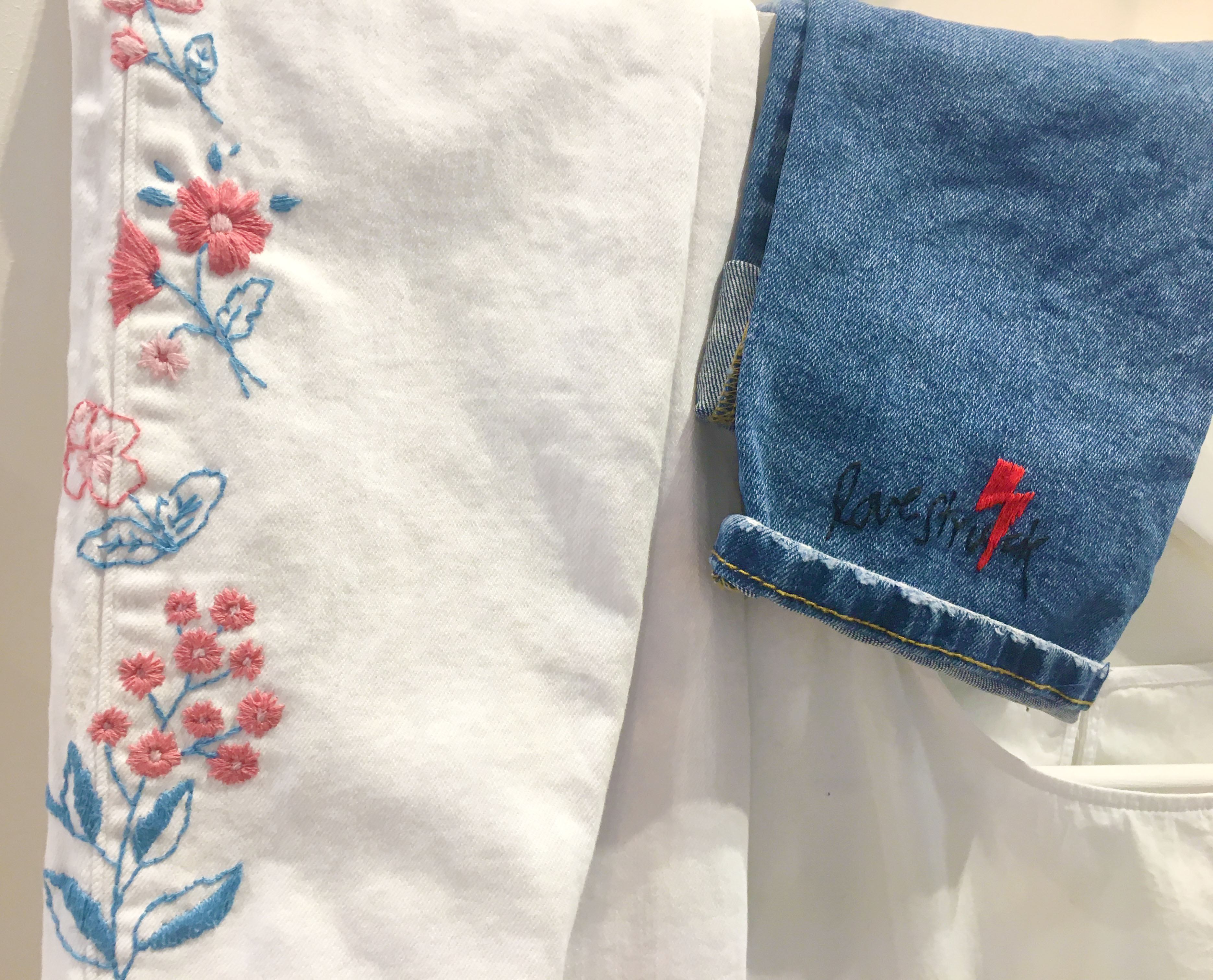 Flower Embroidery on white jeans and Lovestruck embroidery on blue jeans from DMC