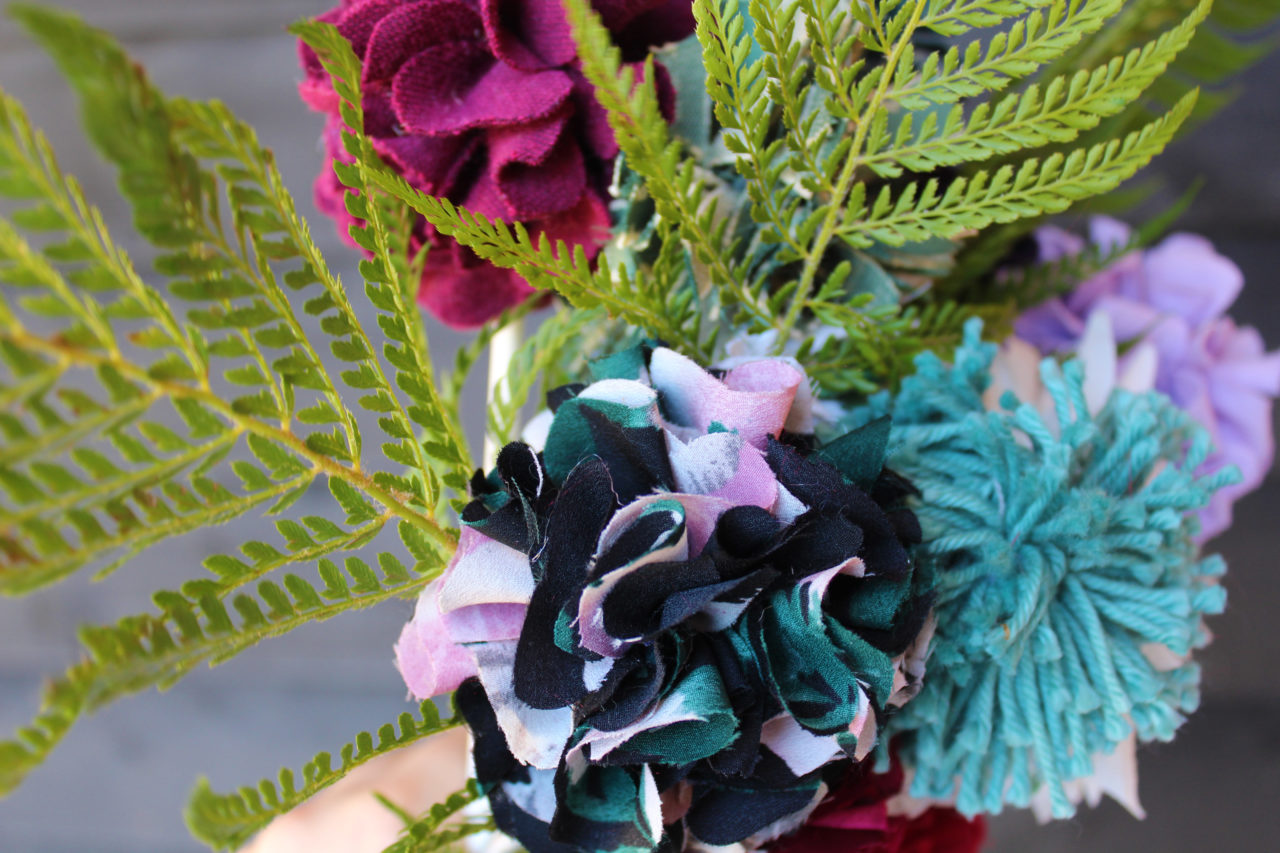 Rag rug flowers made on a hessian base in black and pink colours