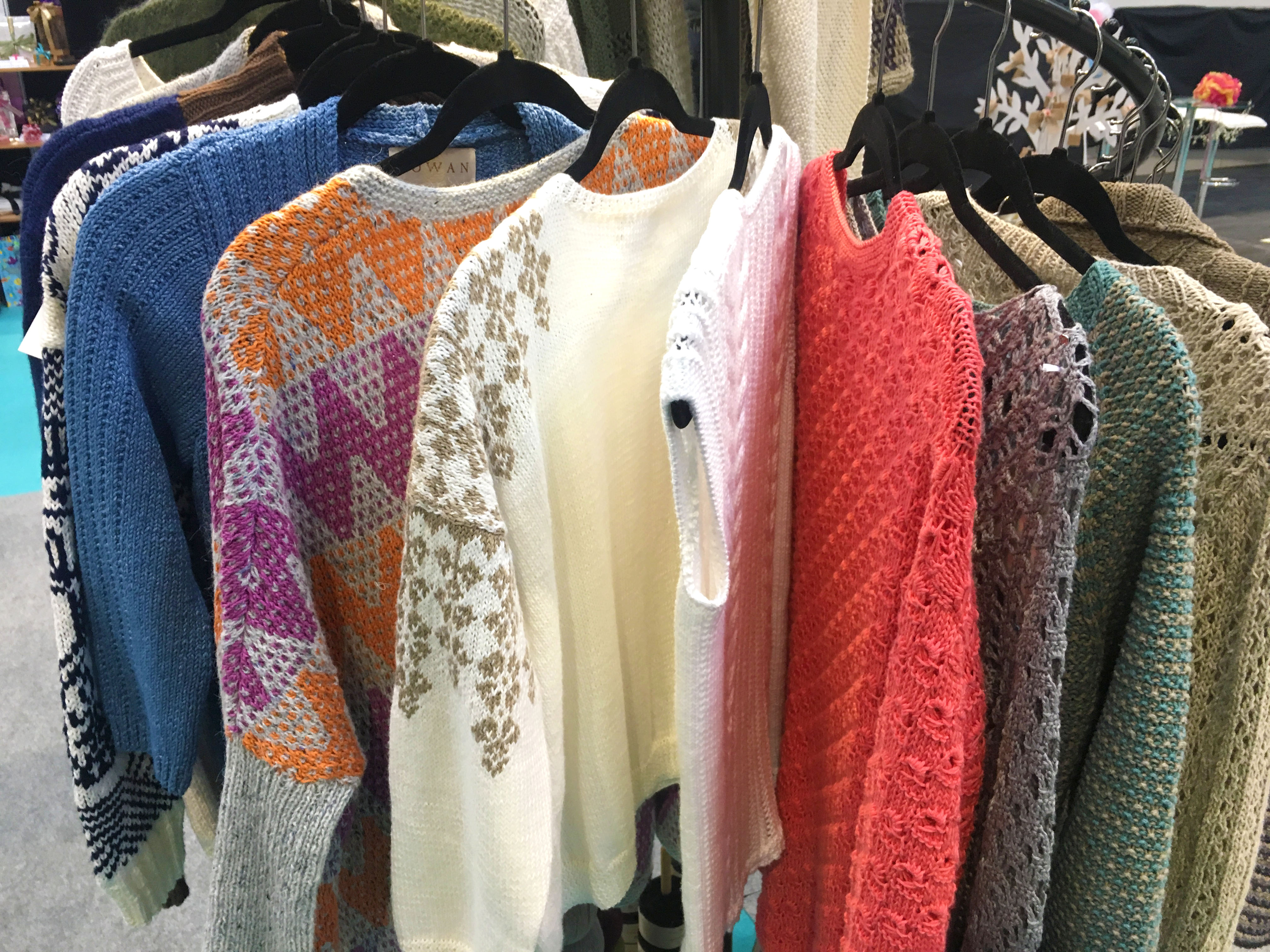 Rowen jumpers made up on hangers