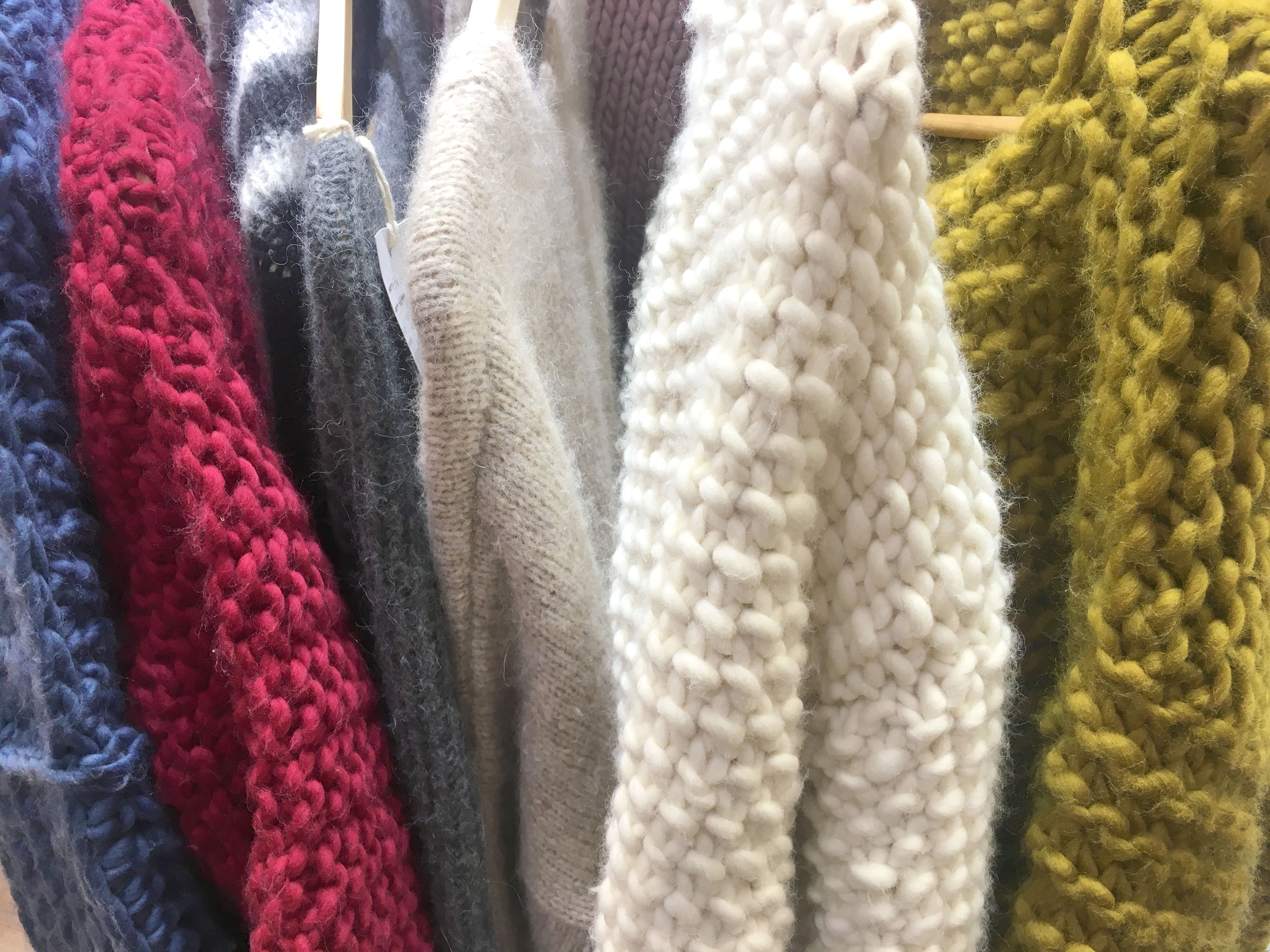 Wool and the Gang Jumpers hanging on display