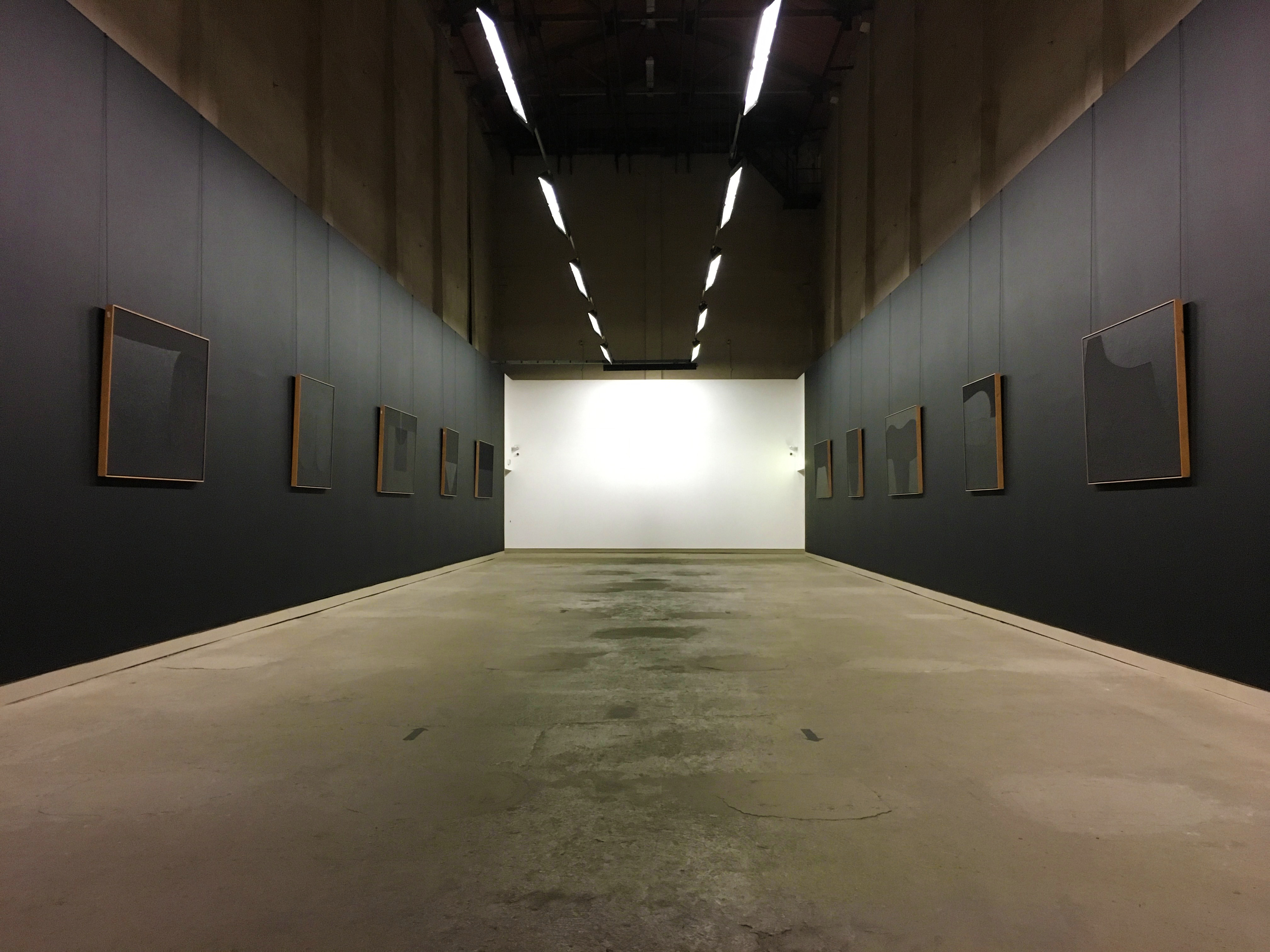 Black room with art by artist Alberto Burri
