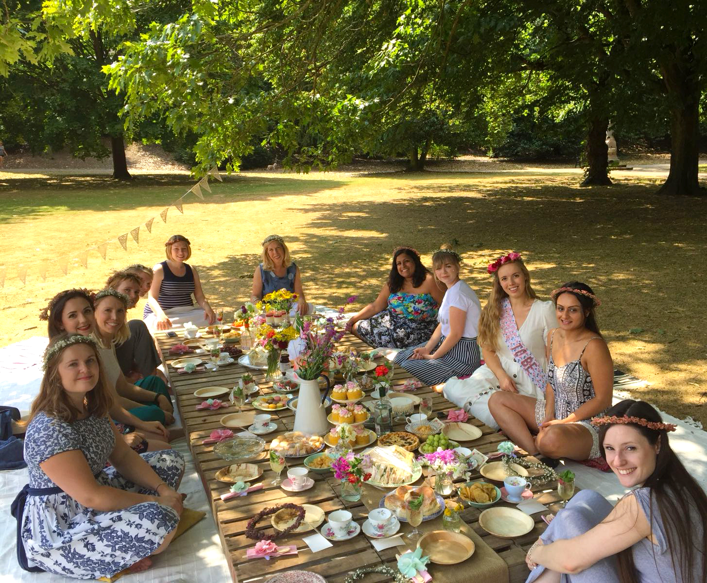 Fun hen do picnic in the park with flowers and crates etc...