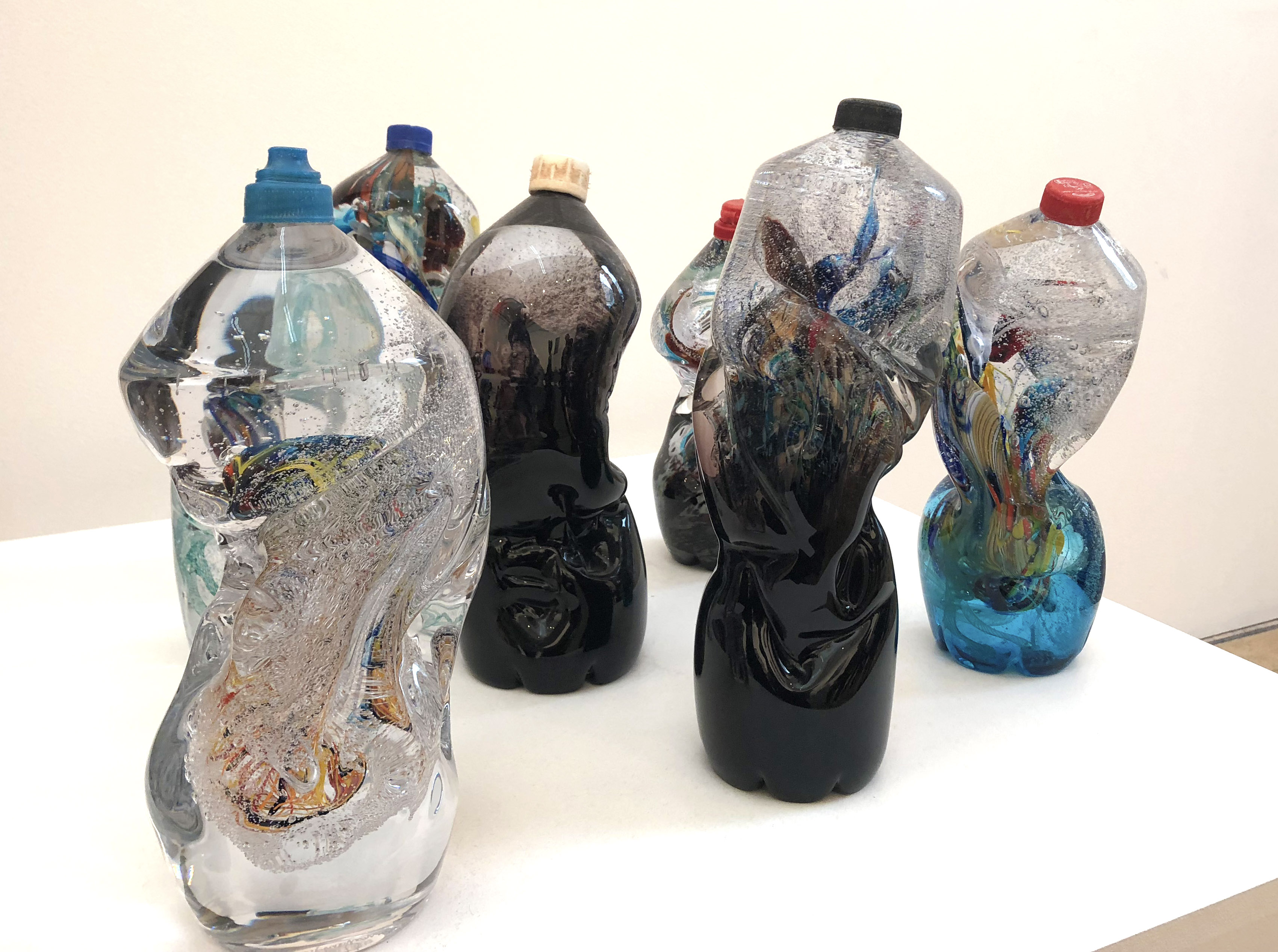 The Seven Stages of Degradation by Sophie Thomas and Louis Thomas glass bottles with plastic tops murano style