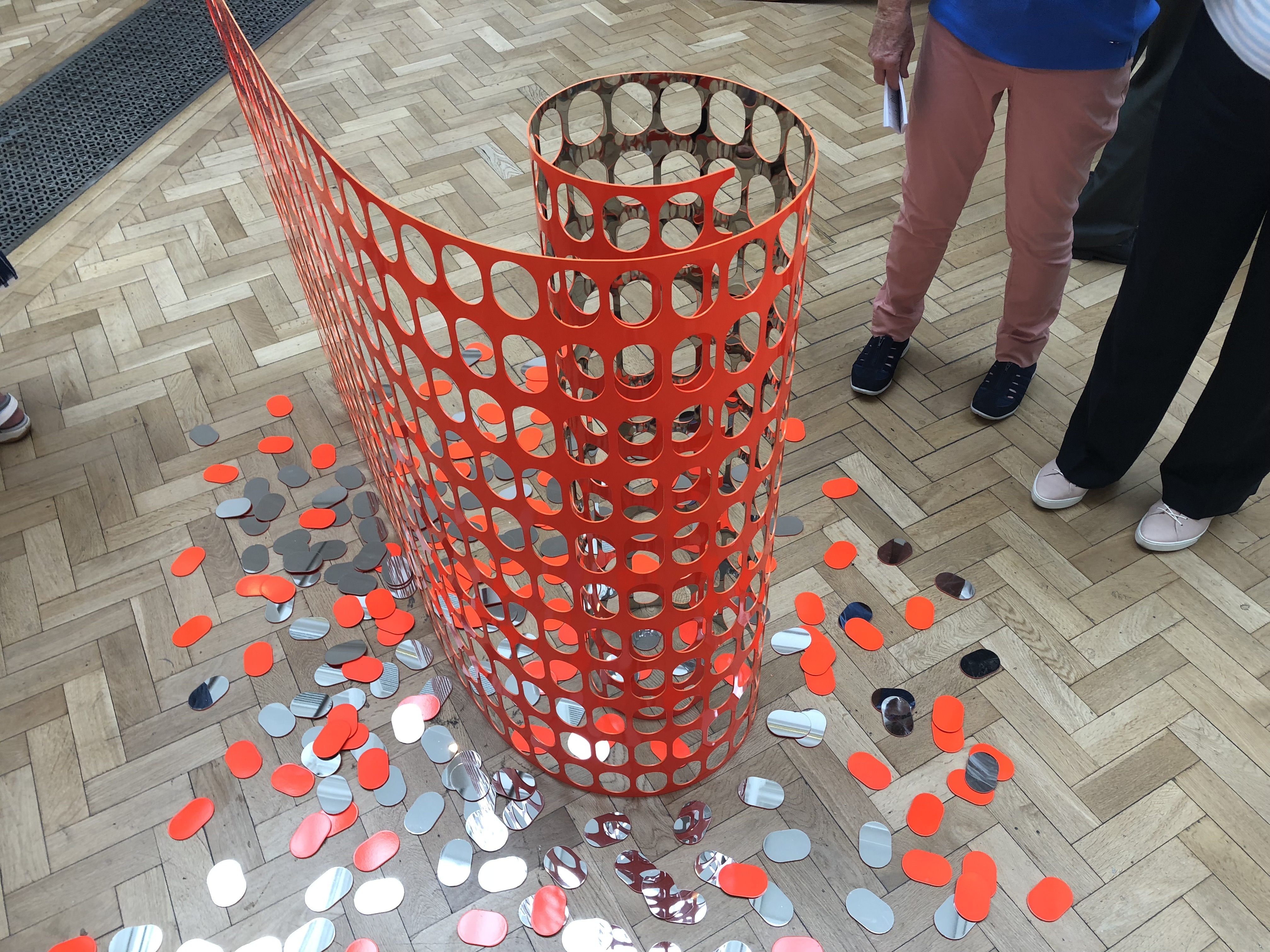 Temporary Fence by Graham Guy-Robinson orange artwork with reflective surfaces