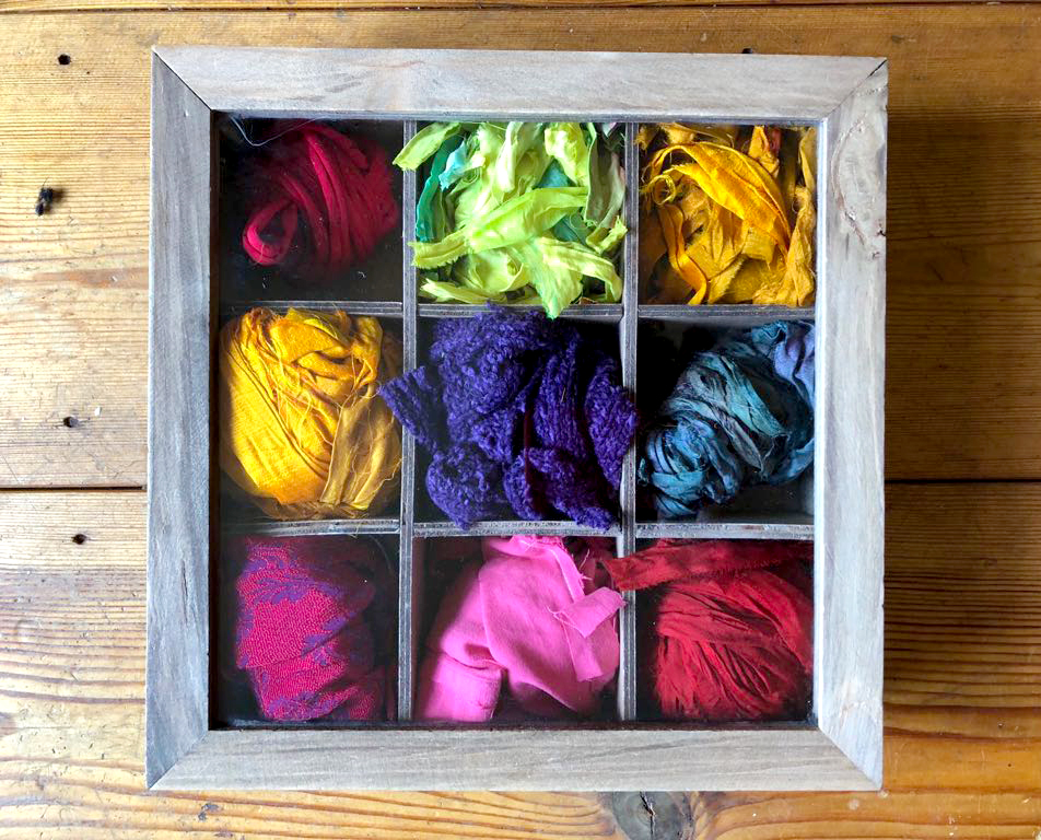 Sari silk rag rug fabric storage in a wooden box