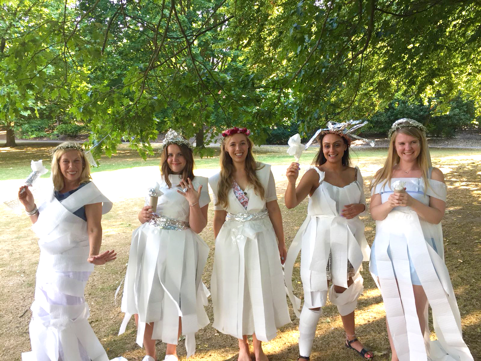 Hen do wedding dress game with dresses made of toilet roll and silver foil.