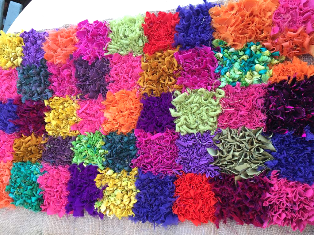 Check sari silk rag rug in bright modern colours made of upcycled saris