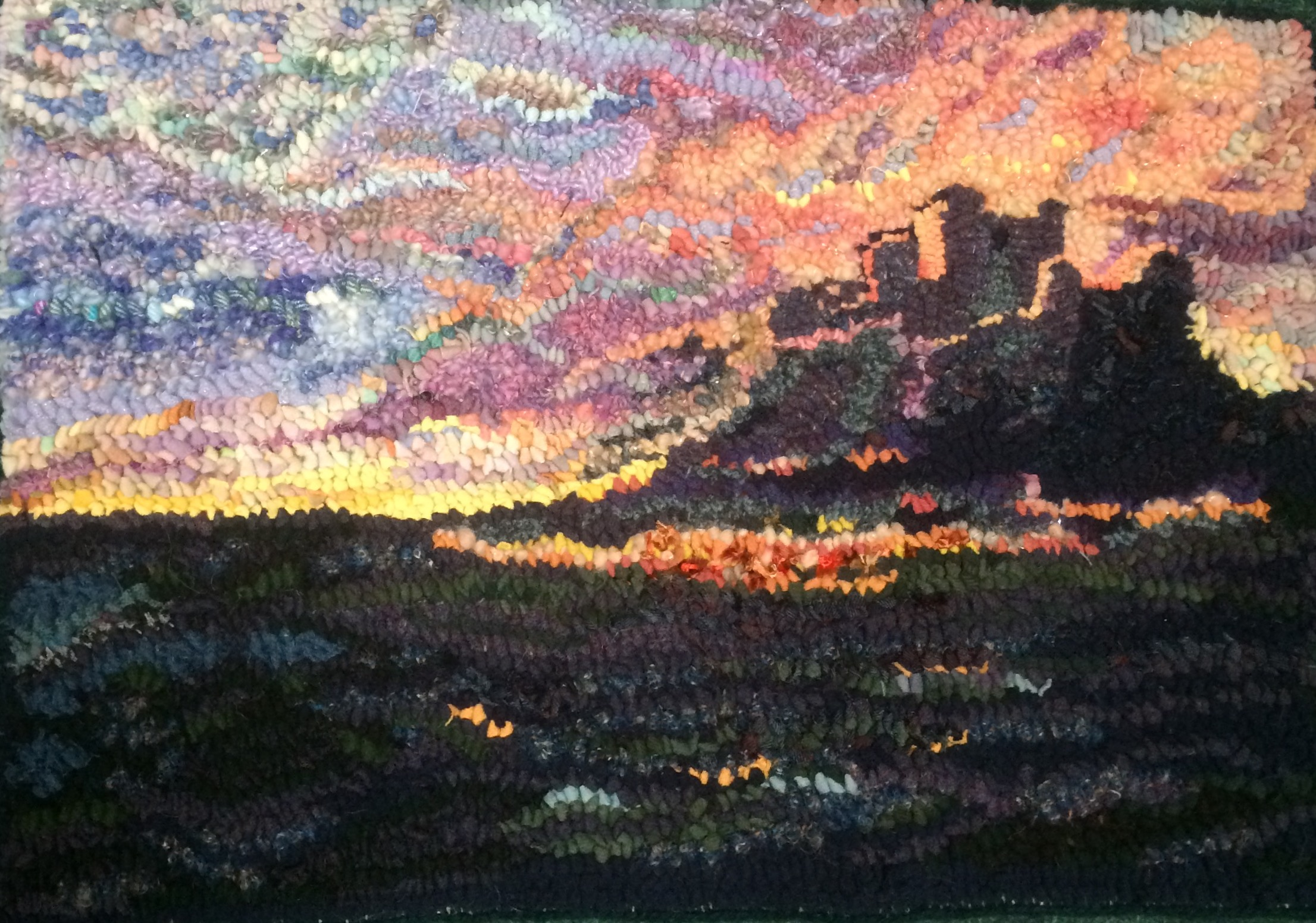 Heather Ritchie Bambrough Sunset rag rug in the hooky technique castle