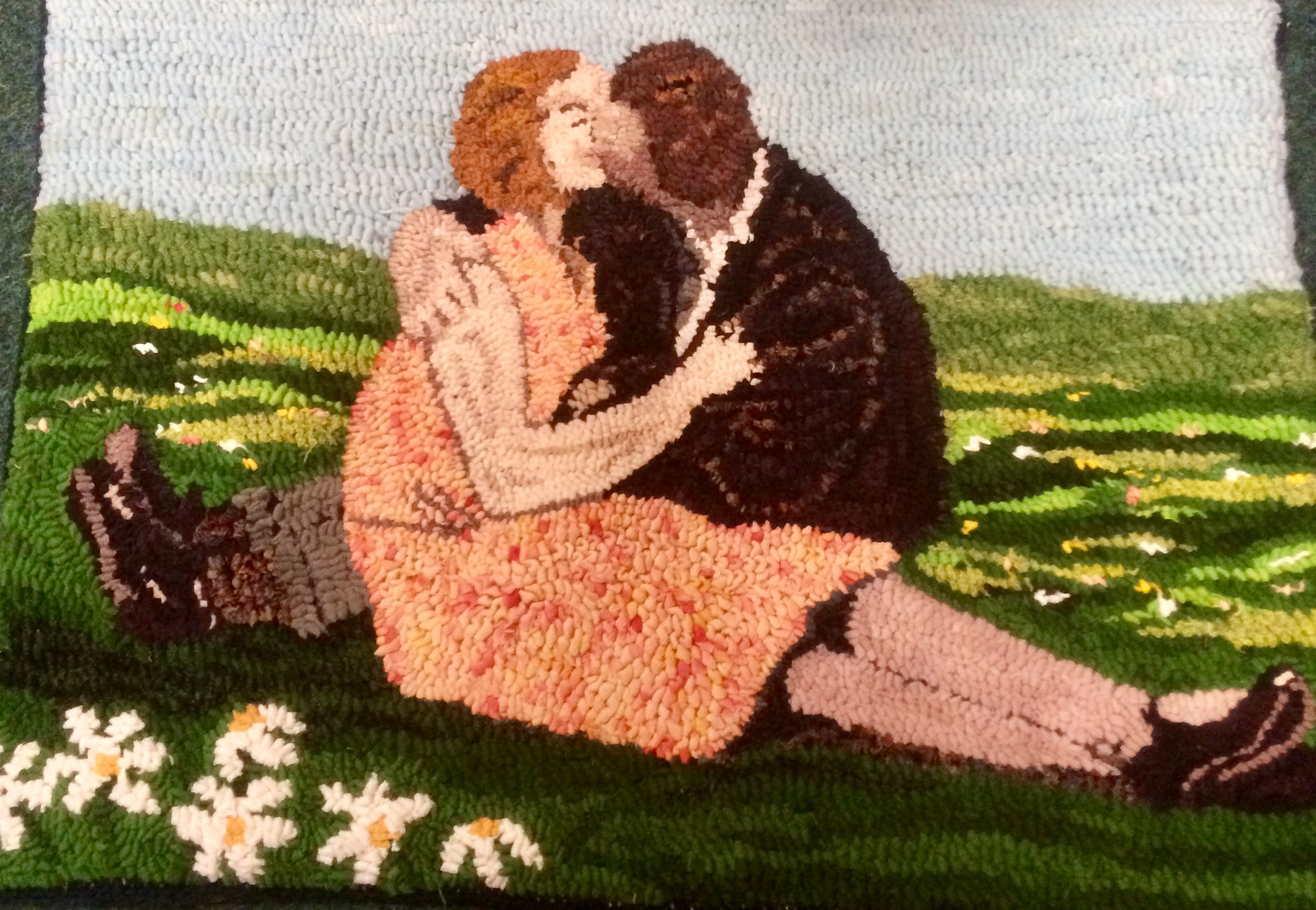 Rag Rug artwork in the loopy technique of a woman and man kissing