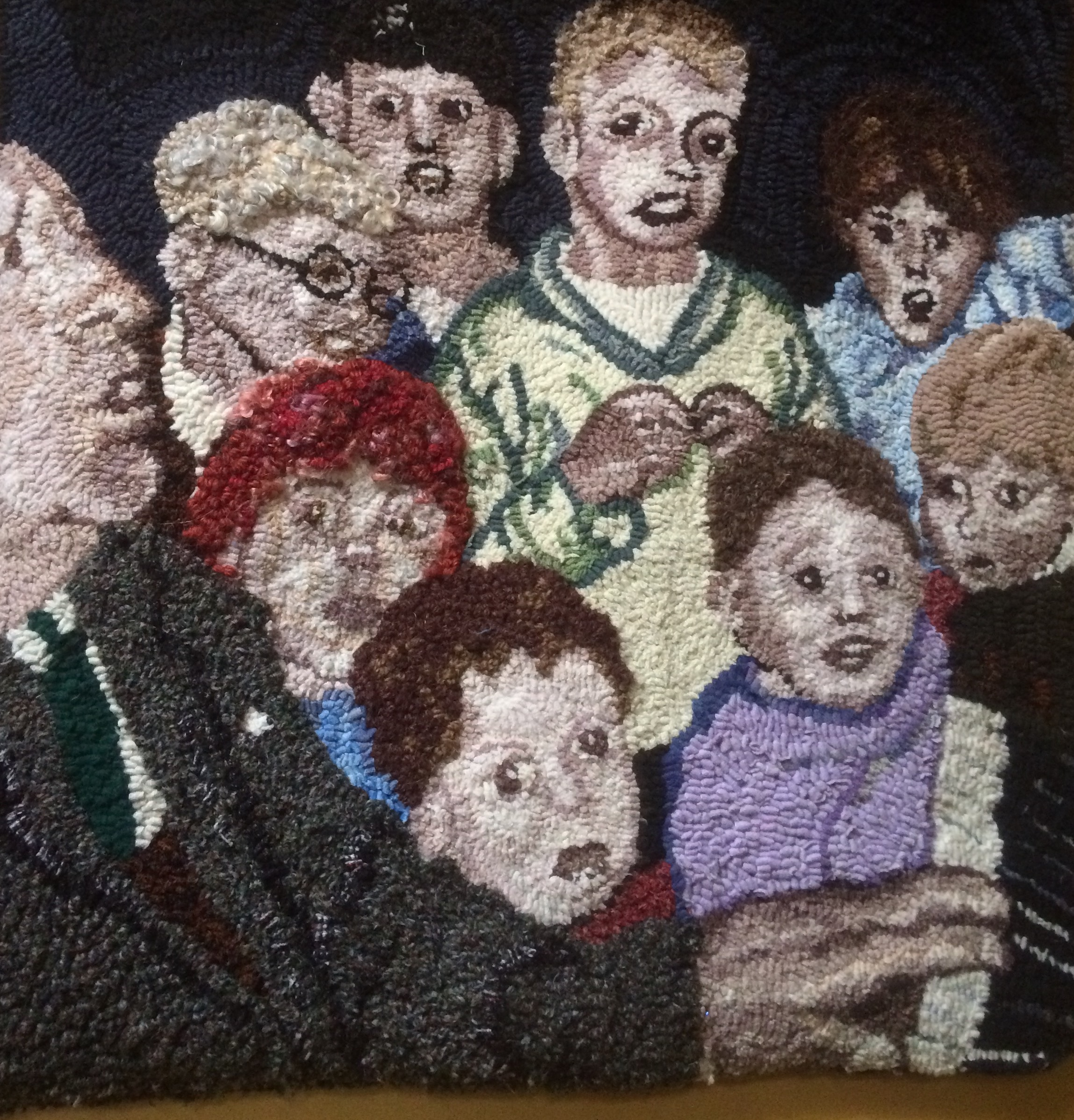Man playing the piano with children rag rug artwork made by Heather Ritchie