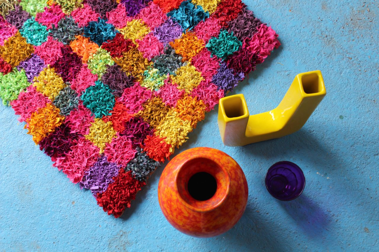 Handmade sari silk ribbon rag rug in oranges, pinks and hot colours