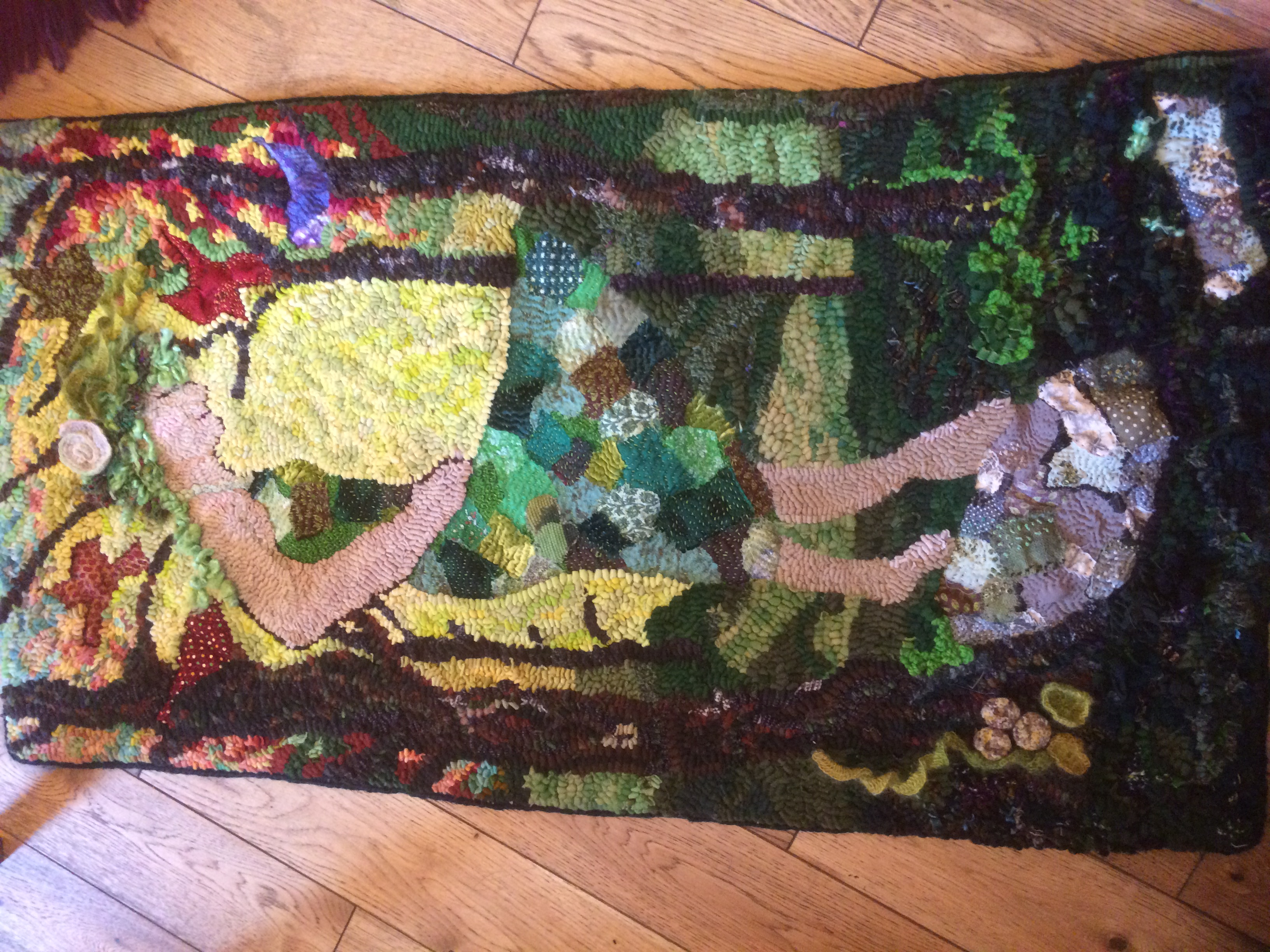 Intricate Rag Rug Design of a lady with patchwork skirt done in the loopy style