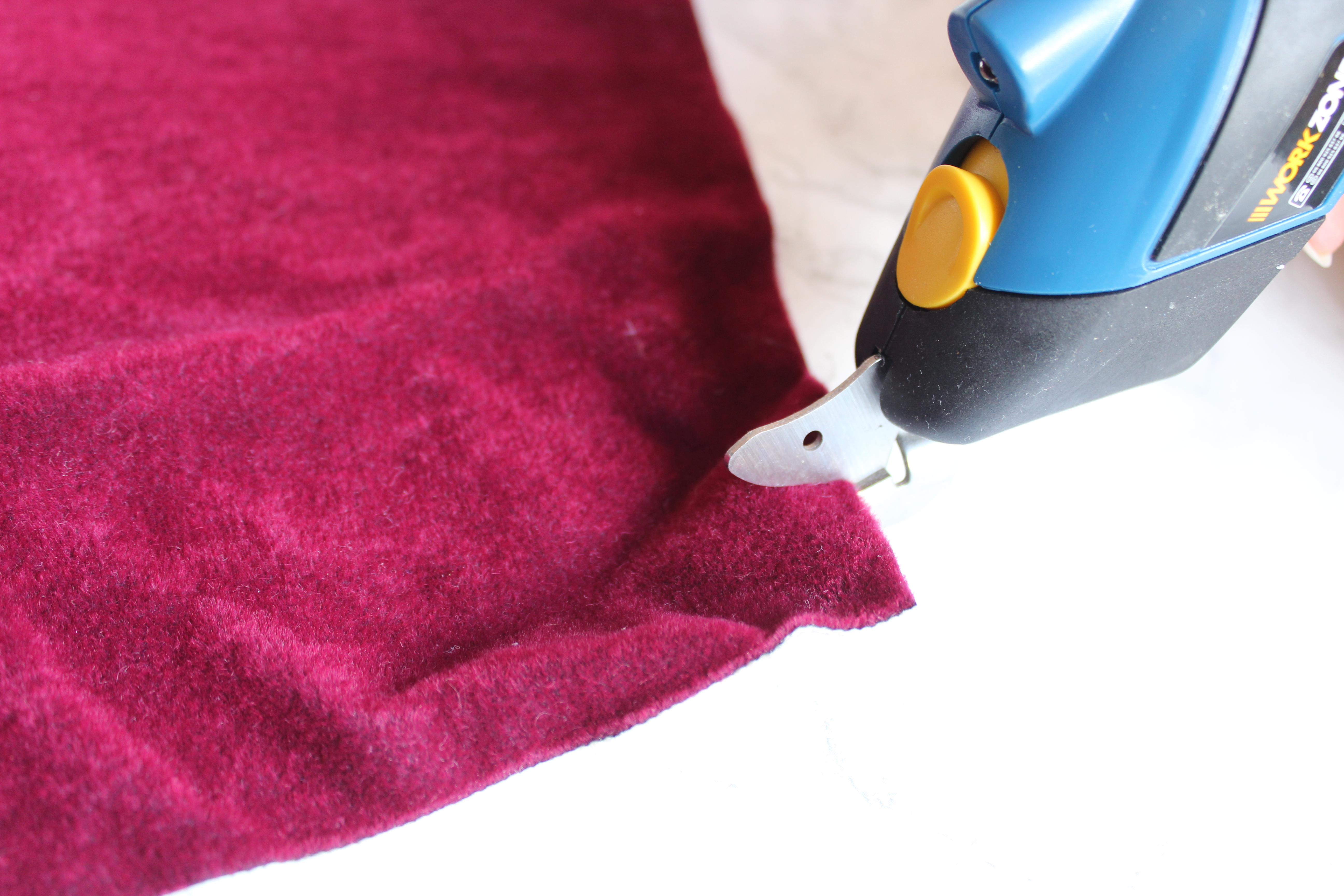 Cutting thick red curtain fabric with the Aldi Workzone Cordless Cutter
