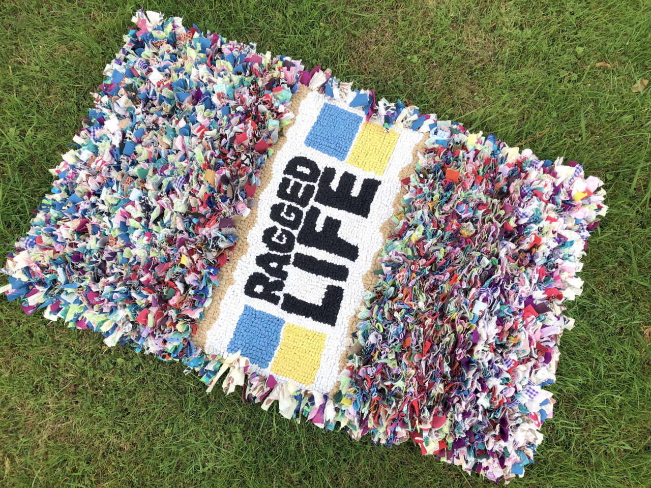 Ragged Life Multicoloured Logo Rag Rug Made using old clothing