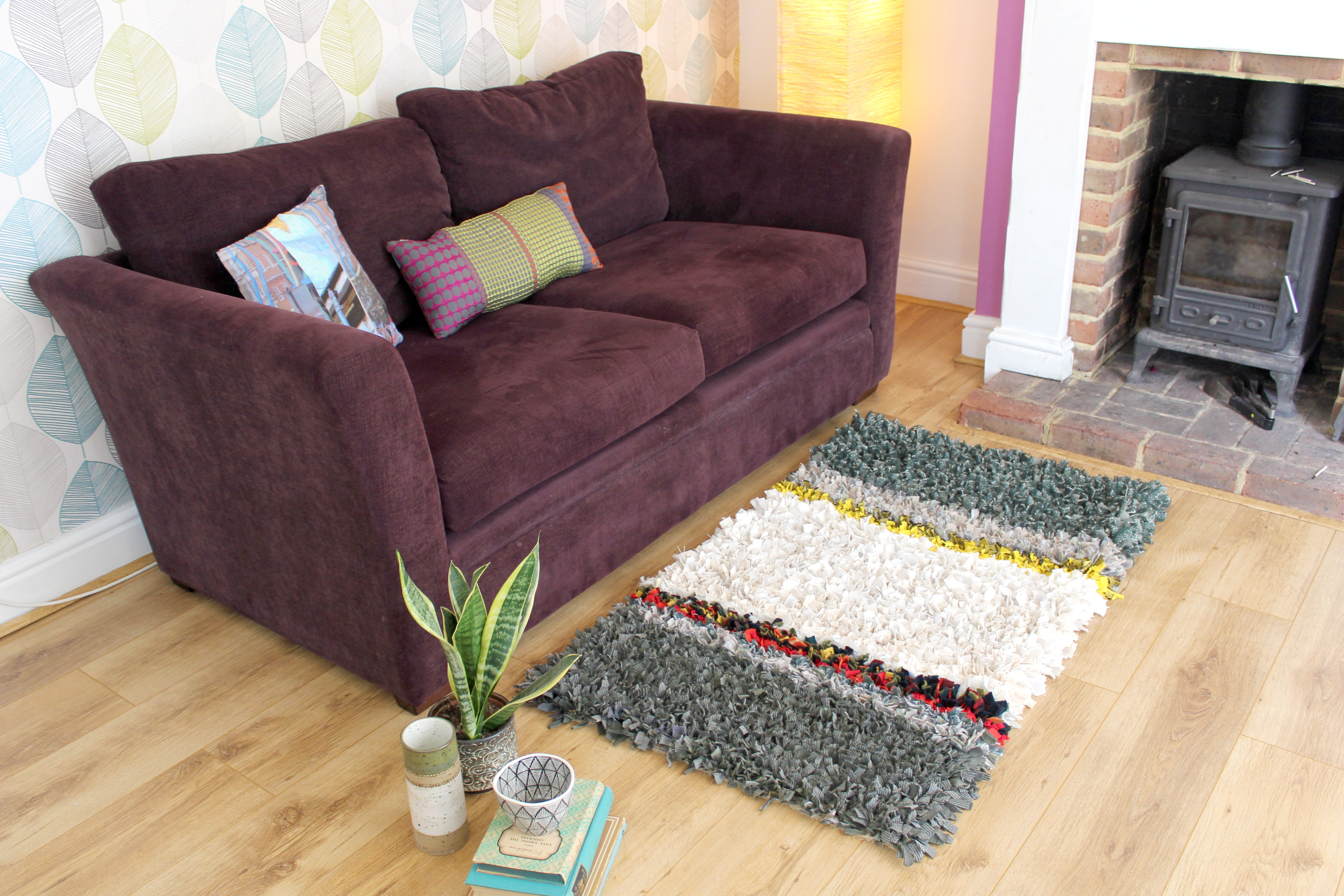 Cosy shaggy rag rug in front of sofa in living room made out of woollen material