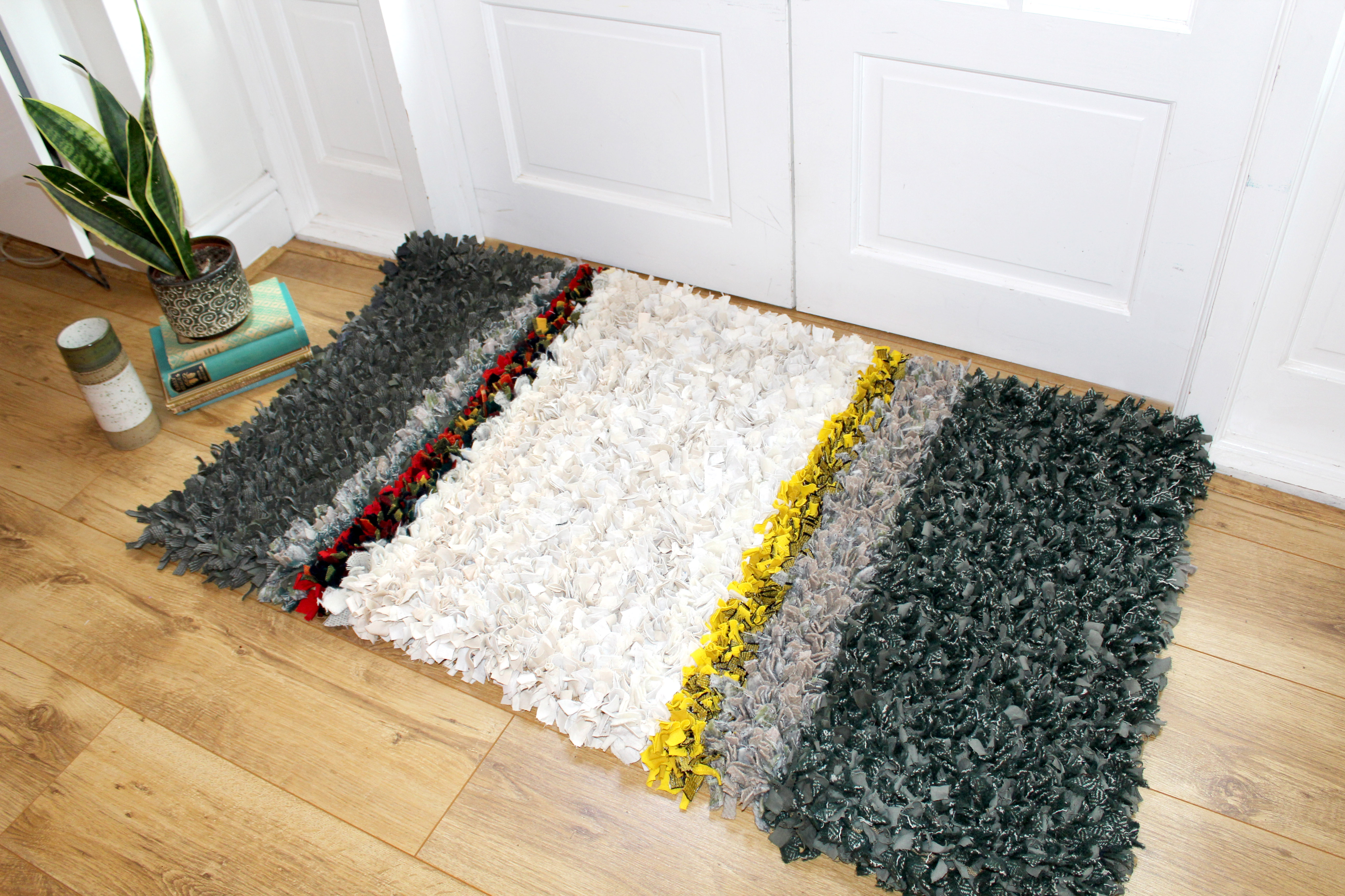 Ragged Life Rag rug on floor made using textile waste and clothing offcuts