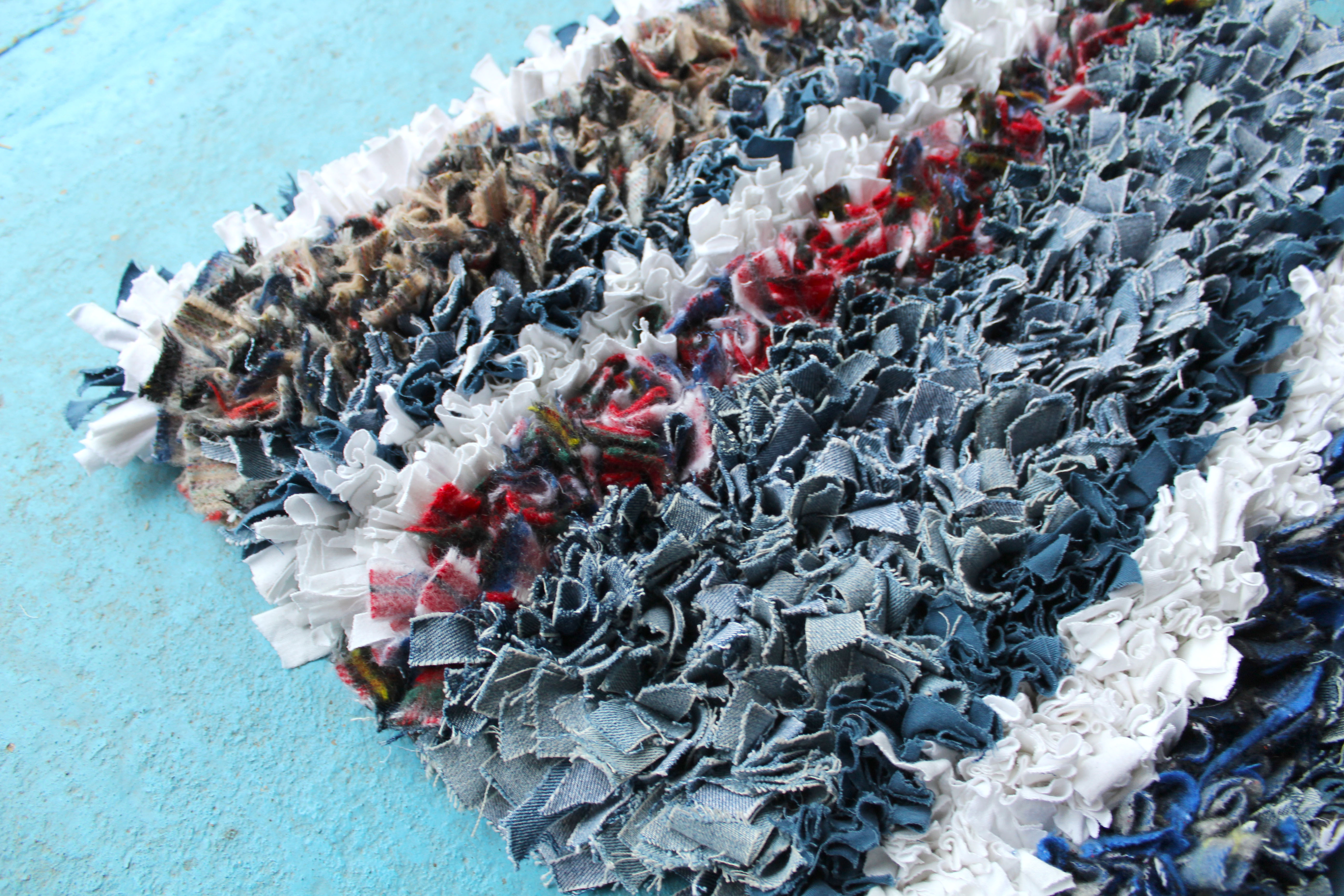 Denim, tartan and white shaggy rag rug in stripes made of old jeans