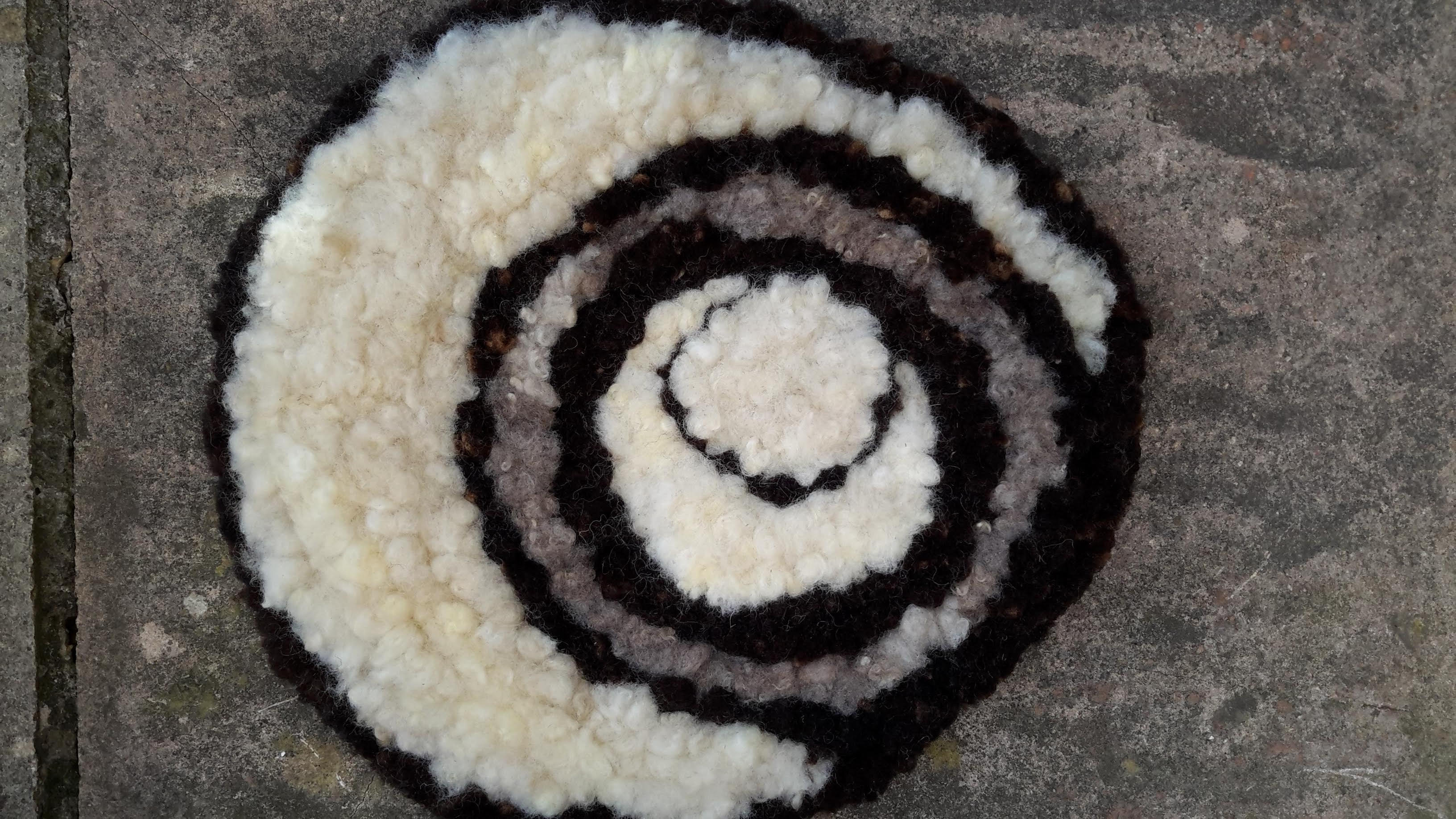 Crop circles black and white rag rug made of Jacob fleece