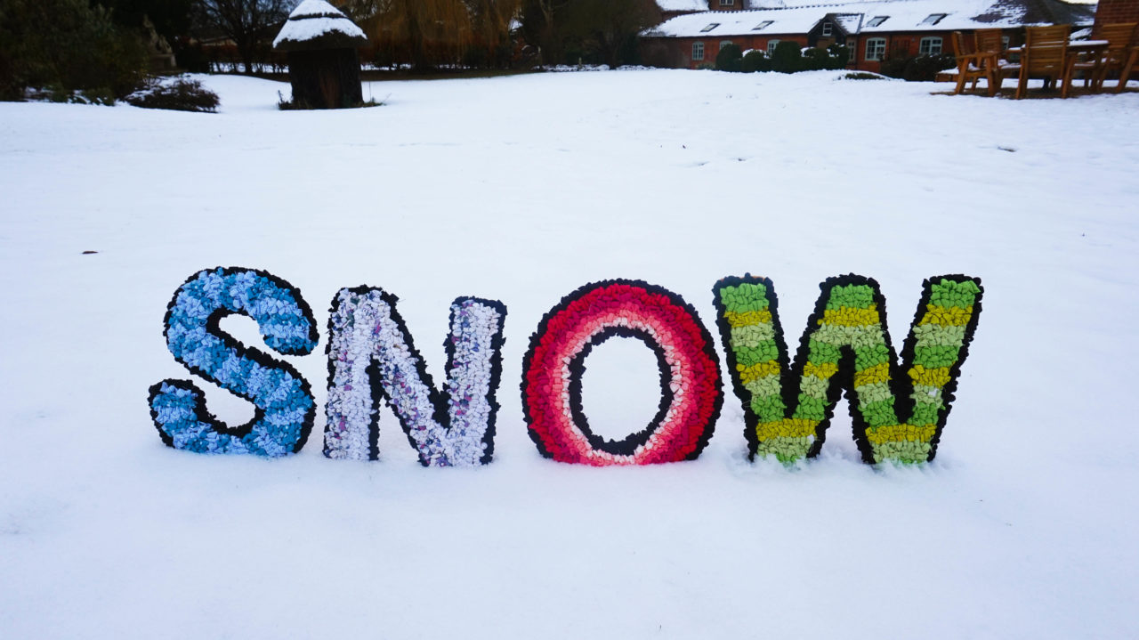 Rag Rug Letters in the Snow made using upcycled textile waste craft