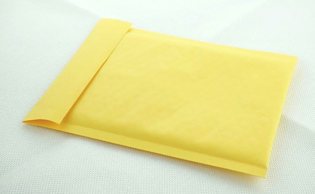 Brown padded envelope sustainable packaging for small businesses