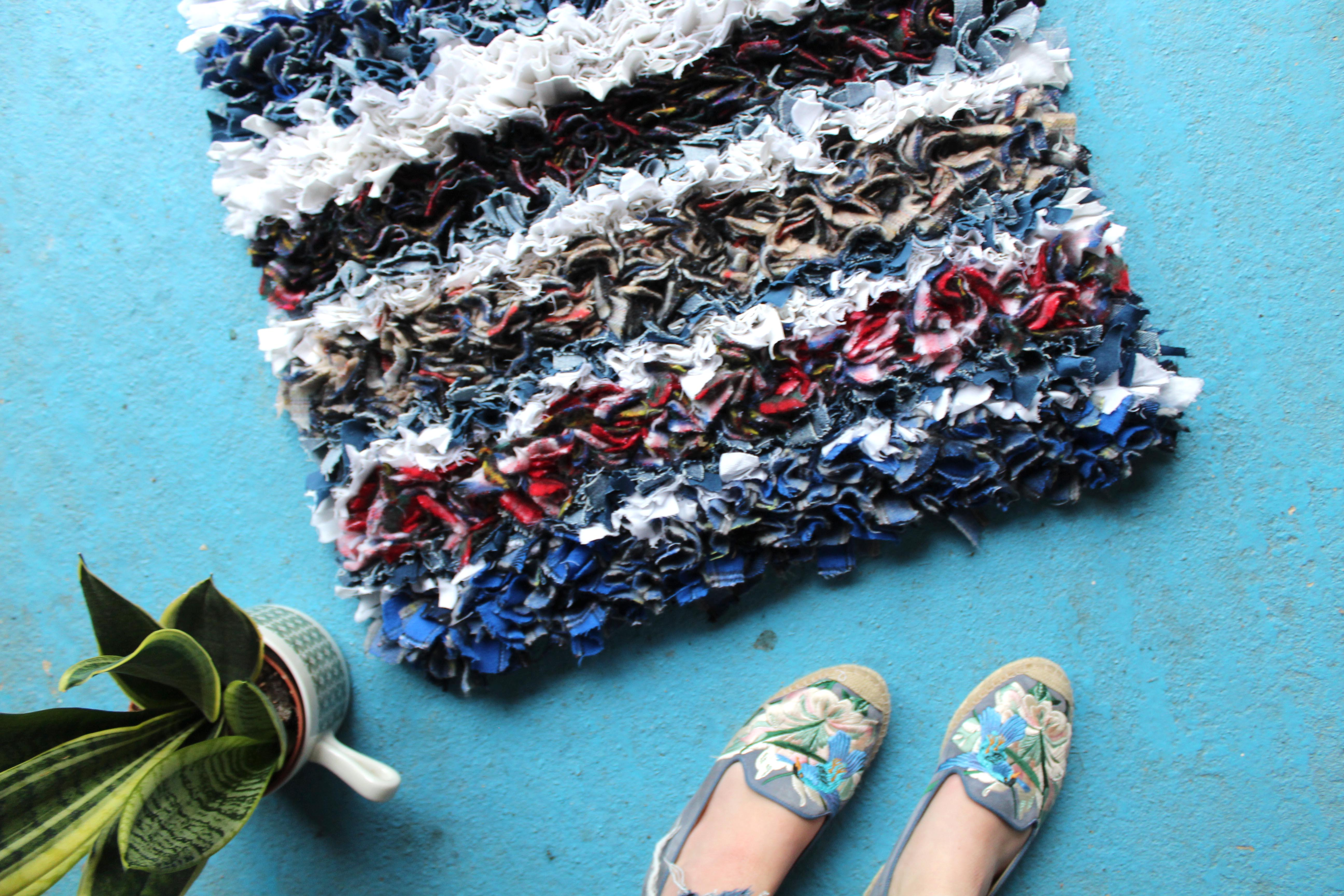 Thick and comfy rag rug with shoes and plant