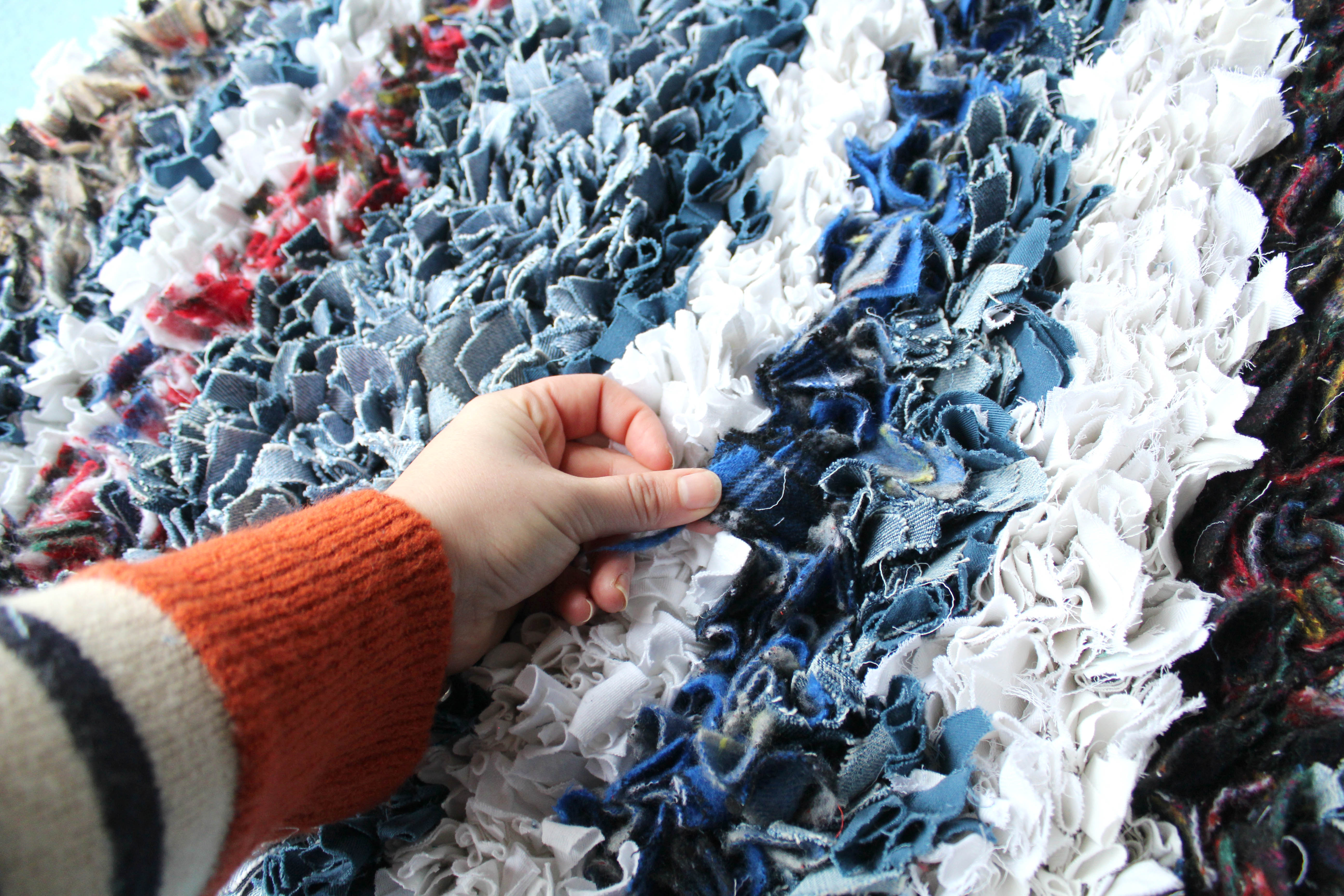 Soft and cosy handmade winter rag rug made using old clothing.