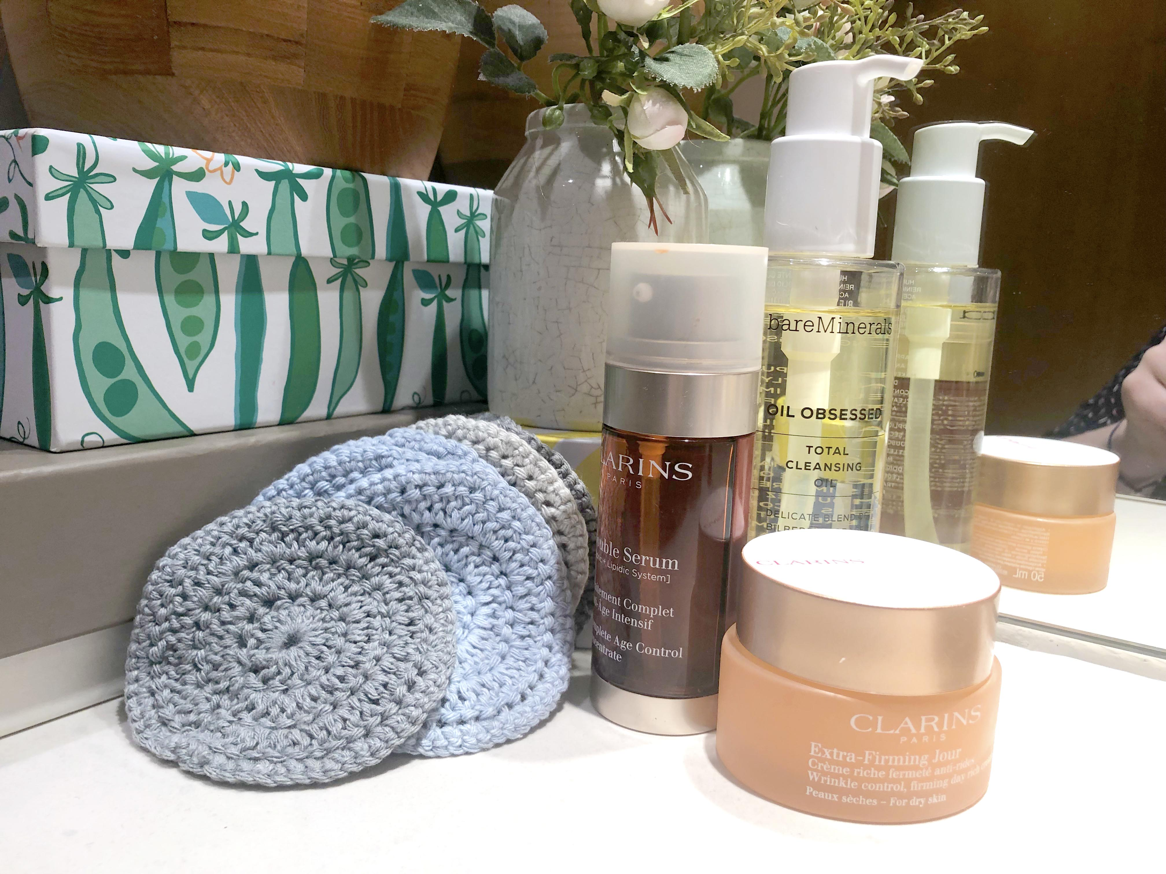 Crochet face pads with products in bathroom